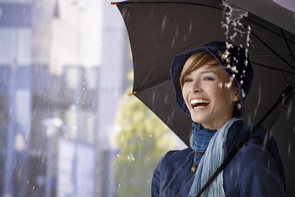 Rainy-woman-with-umbrella-happy